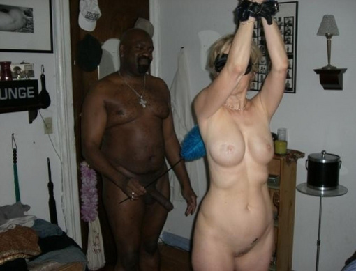 Interracial Photo Blindfolded and Tied Wife with Black Man