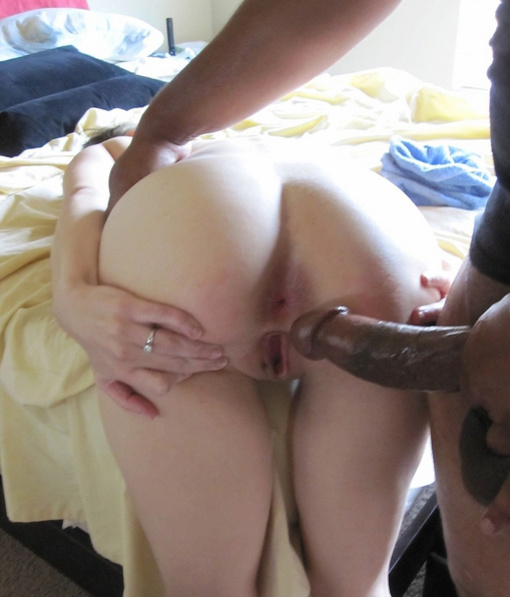 Preparing Her Butt for the Black Dick in Interracial Photo