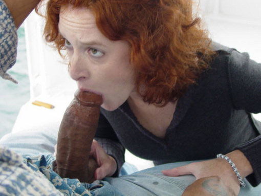 Picture Redhead Girl on Her Knees Sucking a Big Black Dick