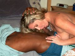 Photo Beautiful Mature Blonde Swallows a Black Cock