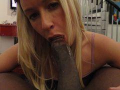 Photo Cute Blonde Swallows a Big Black Dick