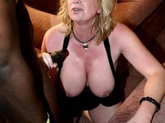 Photo Mature Blonde Wife Giving Handjob to BBC