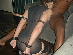 Handcuffed White Wife Sucks Black Cock in Interracial Photo