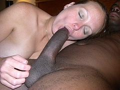 Closeup Interracial Photo of White Girl Sucking Huge Cock