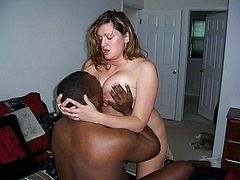 Black Man Sucking Nipples of Fat White Girl in Interracial Photo