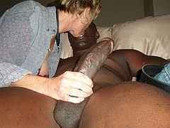 Photo of White Wife Kissing Black Man and Stroking His Cock