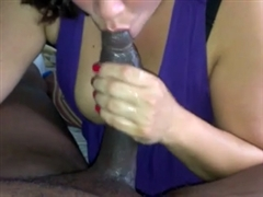 Busty White Woman Sucking on a Big Black Dick