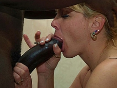 Photo Blonde British Mature Sucking on a Big Black Cock