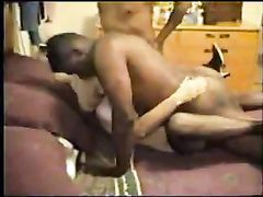 Sleazy Blonde White Cougar Taking Two Black Dicks at Home
