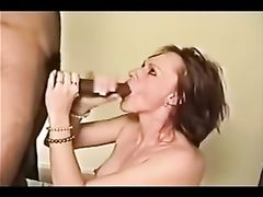 She Sucks a Long Black Dick and Tastes the Cum Flooding Her Face