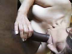 Mature Granny with Black Man Sucking His Dick